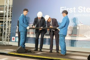 MSC Cruises Executive Chairman Pierfrancesco Vago and CEO of STX France Laurent Castaing cut the first steel of the newly named MSC Virtuosa. Photo credit: MSC/ Ivan Sarfatti