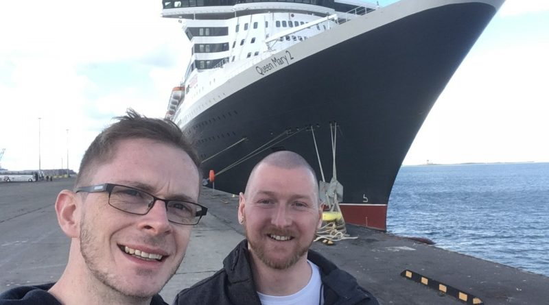Gavin & Luke with Queen Mary 2 behind.